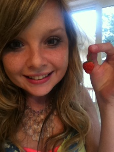 An unconventional 19th birthday present--my first homegrown strawberry.
