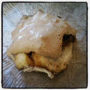 pumpkin chip cinnamon roll with vanilla chai protein frosting