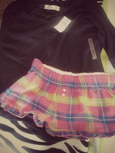Navy easy fit sweater: Hollister. Pink plaid PJ shorts: Hollister.