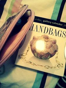Sparkly pink makeup bag (Forever 21) and a handbags daily calendar.
