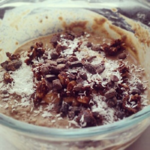 Dessert for breakfast: chocolate PB chia pudding made with Vega chocolate protein powder and peanut flour, topped with coconut shreds, cacao nibs and Kit's Organic chocolate coconut bar.