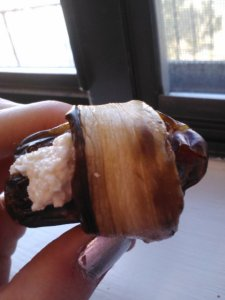 Eggplant 'bacon' wrapped date stuffed with cashew 'cream cheese'.