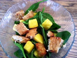 Spinach salad with frozen mango and Gardein chick'n nuggets.