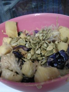 Kelp noodle stirfry. Kelp noodles, fresh pineapple, red cabbage, spinach, peanut flour curry sauce, raw pumpkin seeds.
