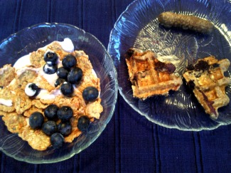 Yogi blueberry granola crisps over Greek yogurt, half a homemade blueberry waffle, veggie breakfast sausage.