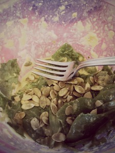 Spinach salad with nooch dressing and sprouted pumpkin seeds.