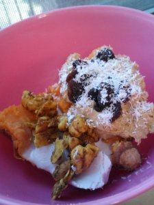 Another dinner: Thai stuffed sweet potato. Half a large sweet potato topped with peanut flour paste and raisins/coconut shreds on one side, coconut cream and raw Thai curry cashews on the other.