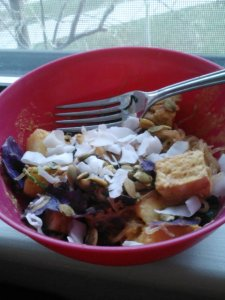 Fully loaded kelp noodle stirfry: kelp noodles, peanut flour/curry/coconut aminos sauce, pineapple/mango, spinach, red cabbage, pan fried tofu, coconut flakes and sprouted pumpkin seeds.