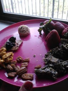 Raw snackplate. Cacao nib Cocoroon, organic strawberries, southwestern ranch kale chips, orange rosemary pecans, Thai lemon curry cashews, currant flacker with homemade blueberry vanilla chia jam.