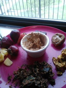 Snack: an almost-raw snackplate with fresh pineapple+strawberries, part of a raw brownie bar, fig with cashew butter, Thai curry cashews, chipotle kale chips and PB2 dip.