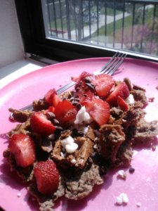Quinoa flour+chocolate Sunwarrior protein waffle. Topped with strawberries, cacao nibs and coconut butter.