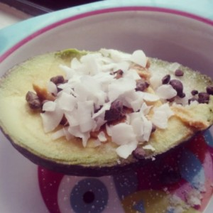 Random but surprisingly good snack: half an avocado sprinkled with stevia, topped with organic crunchy PB, cacao nibs and coconut shreds.