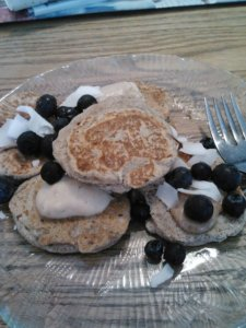 A non-raw breakfast for once: GF buckwheat+coconut flour based pancakes, topped with vanilla Sunwarrior 'frosting', Justin's vanilla almond butter, blueberries and coconut flakes.