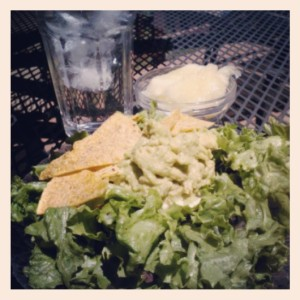 Lunch: raw taco salad. Base of romaine, dressed with lime juice and cracked pepper, topped with homemade guac, homemade sprouted and dehydrated corn chips. Side of canary melon and water.