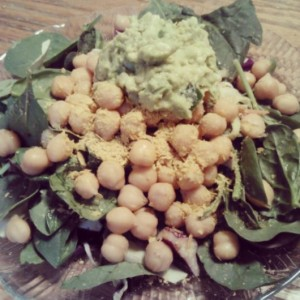 Salads on salads on salads. Organic spinach base, organic chickpeas topped with nooch, homemade guac.