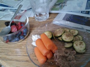 Friday's lunch. Snackplate of carrots, homemade bean dip, homemade raw 'goat cheese' dip, zuke with garlic gomasio. Side of leftover berries.