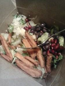 Native Foods leftovers. Ensalada Azteca salad+sweet potato fries and some black beans, sauerkraut and pomegranate seeds.