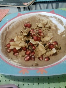 Raw protein bowl for breakfast on Saturday. Garden of Life RAW Marley coffee protein powder+coconut flour+almond milk base, topped with homemade raw coconut 'bacon', pomegranate seeds and a little chia ginger rawnola.