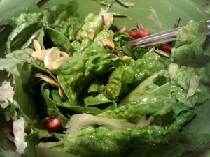 Salad with romaine, leftover black bean spaghetti, pomegranate seeds, pumpkin seeds and sauerkraut.