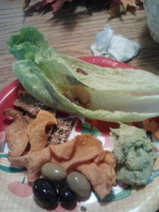 Thanksgiving snack plate in lieu of lunch. Date+romaine wraps, sweet potato chips, olives, homemade guac, Skinny Crisps.