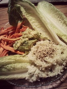 Random dinner of romaine hearts, homemade guac, cilantro lime cauliflower 'rice' and dehydrated sweet potato fries.