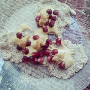Raw flax pancakes topped with Sunwarrior protein sauce, pomegranate and date syrup.