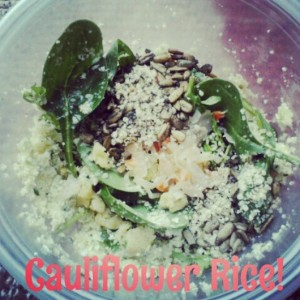 Superfood salad for lunch featuring cilantro lime cauliflower rice. Base of spinach+arugula, with cauliflower rice, hemp hearts, spicy sprouted sunflower seeds, Farmhouse Culture raw jalapeno kraut and a little raw taco filling.