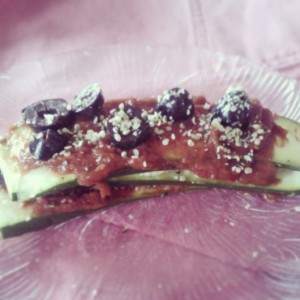 And zucchini rawsagsna. Layered with homemade marinaraw sauce, raw cashew cheez, kalamata olives and hemp seeds.