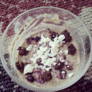 Valentine's Day breakfast of cherry vanilla Sunwarrior chia pudding topped with coconut manna and homemade raw brownie bites.