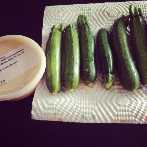 Keepin' it simple at the farmer's market. Locally-grown mini zucchinis and local-made smoked hummus.