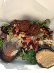 """Street"" falafel, cucumber salad, spicy mango sauce, hummus and cabbage slaw for dinner in the hot hot sun."